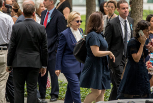 Hillary Clinton Hurriedly left 9/11 Ceremony-Shaking & Buckled At Her Knees Getting into Motorcade